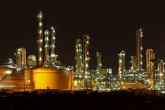 Chemical plant. Chemical production facility at night Stock Photos