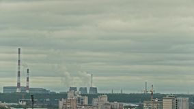Chemical plant on city skyline - vapor and smoke from pipeline, time-lapse stock footage