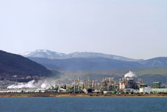 Chemical plant in nature. Factory installed on the seashore, with natural scene in the background Stock Photography