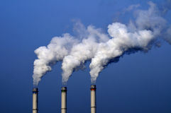 Chemical plant/power station. Chemical plant air pollutions with white clouds of smoke royalty free stock photography