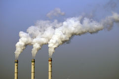 Chemical plant/power station. Chemical plant air pollutions with white clouds of smoke Stock Images