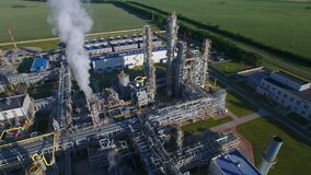 Chemical Plant produces gasoline and mineral fertilisers. Orbit round aerial flying morning sunshine summer fields and