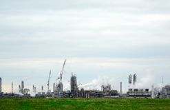Chemical plant with smoking pipes. The chemical plant with smoking pipes Royalty Free Stock Photo