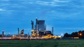 Chemical plant in twilight. View on illuminated operational chemical plant in twilight Stock Photos