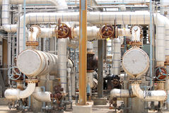 Chemical Process Piping. A pair of chemical process exchangers with valves, gauges and piping in a petrochemical plant Royalty Free Stock Image