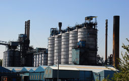 Chemical Processing Factory. Against a clear blue sky Stock Photos