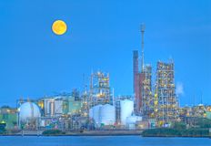 Chemical production facility. On a river bank, moonlit during early night Stock Images