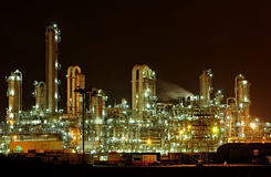 Chemical production facility at night. Towers and pipes of a chemical production facility at night Royalty Free Stock Photo