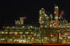 Chemical production facility at night. Intimate details of a chemical production facility at night Stock Photos