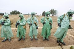 Chemical protection suites Stock Photos
