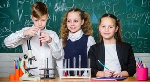 Chemical reaction occurs when substance change into new substances. Pupils study chemistry in school. Chemical substance. Dissolves in another. Kids enjoy stock photos