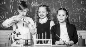 Chemical reaction occurs when substance change into new substances. Pupils study chemistry in school. Chemical substance. Dissolves in another. Kids enjoy stock image