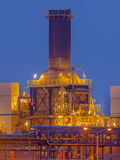 Chemical reactor on a plant. Chemical reactor with chimney on a plant  in an industrial factory area Stock Photos