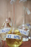 Chemical reagents in glass flask. Chemical yellow reagents in glass flask lab stock photo