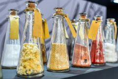 Chemical reagents in glass jars. Jars are arranged in even rows royalty free stock photo