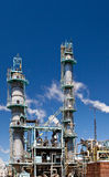 Chemical Refinery Plant Smokestack Tower Pipeline. Heavy industry Stock Images