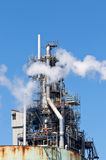 Chemical Refinery Plant Smokestack Tower Pipeline. Heavy industry Stock Photo