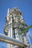 Chemical refinery tower. In sunny day Royalty Free Stock Photo