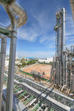 Chemical refinery tower. In sunny day Royalty Free Stock Images