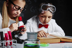 Chemical science. Working kids in chemical laboratory Stock Image