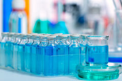 Chemical scientific laboratory blue glass bottles Stock Photo