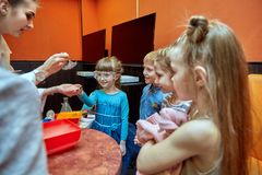 Chemical show for kids. Professor carried out chemical experiments with liquid nitrogen on Birthday little girl. Chemical show for kids. Professor carried out stock photography