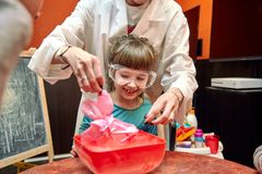 Chemical show for kids. Professor carried out chemical experiments with liquid nitrogen on Birthday little girl. stock images