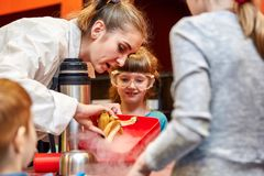 Chemical show for kids. Professor carried out chemical experiments with liquid nitrogen on Birthday little girl. Chemical show for kids. Professor carried out stock photo