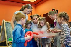 Chemical show for kids. Professor carried out chemical experiments with liquid nitrogen on Birthday little girl. Chemical show for kids. Professor carried out stock photos