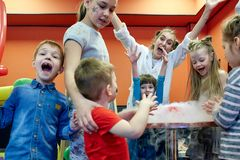 Chemical show for kids. Professor carried out chemical experiments with liquid nitrogen on Birthday little girl. stock photos
