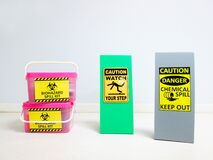 Free Chemical Spill Kit Yellow Bucket And Biohazard Spill Kit With Warning Danger Caution Hazard Tag Sign Or Symbol For Emergency Case. Stock Image - 182006661