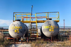 Chemical storage tank with sulfuric acid. Outdoors, plant in Russia. Inscription on Russian on tank: Sulfuric acid Stock Image