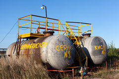Chemical storage tank with sulfuric acid. Outdoors, plant in Russia. Inscription on Russian on tank: Sulfuric acid Royalty Free Stock Photo
