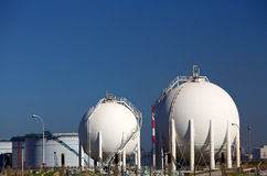 Chemical storage tanks. White chemical storage tanks at a petrochemicals manufacturing plant Stock Photography