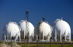 Chemical storage tanks. White spherical storage tanks at a petrochemicals plant Royalty Free Stock Photography
