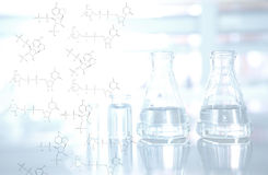 Chemical structure with flask and vial background in science lab. Light on chemical structure with flask and vial background in science laboratory Stock Photography