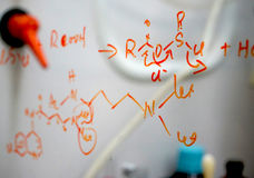 Chemical structure written on glass stock photography
