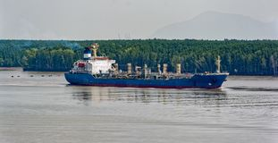 Chemical Tanker vessel sails upstream the Song Long River. Chemical Tanker vessel sails upstream the Song Long River from Vung Tau bay to Ho Chi Minh City royalty free stock image