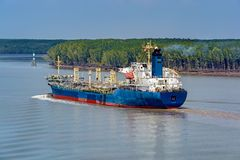 Chemical Tanker vessel sails upstream the Song Long River. Chemical Tanker vessel sails upstream the Song Long River from Vung Tau bay to Ho Chi Minh City royalty free stock photo