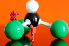 Chemical team with a molecular model of chloroform Royalty Free Stock Image