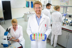 Chemical technician hold colorful test tubes Stock Photo