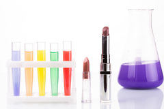 Chemical test tubes and lipstick. harmful Stock Images