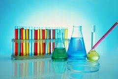 Chemical test-tubes with medicine dropper. On color background stock photo