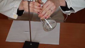 Chemical titration using a burette stock footage