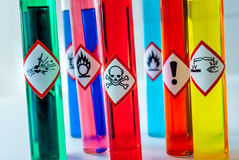Chemical Toxic pictogram. Focus on multiple colored test tubes Royalty Free Stock Photo