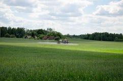 Chemical treatment spray pesticide on field Stock Photos