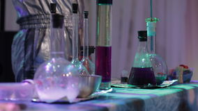 Chemical tricks in a secret lab. Scientist conducting chemical laboratory research stock video