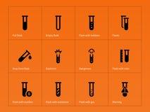 Chemical tube icons on orange background Royalty Free Stock Photo