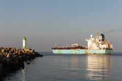 Chemical Vessel leaving the port in clear weather. Pier view Royalty Free Stock Images