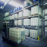 Chemical warehouse. With plastic tank and conveyor Royalty Free Stock Photos